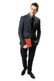 Бизнесмен стоя и держа планшет Стоковое фото RF