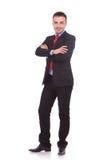 Бизнесмен стоя на белой предпосылке студии Стоковые Изображения RF