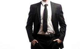 Бизнесмен стоя на белой предпосылке Стоковое Фото