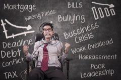 Бизнесмен стресса связанный на классе Стоковое Изображение RF