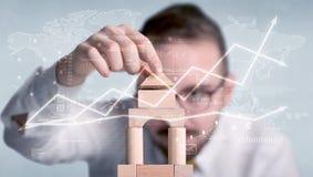 Бизнесмен строя башню Стоковые Изображения RF