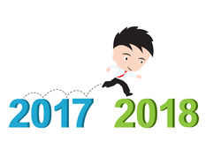 Бизнесмен счастливый к бежать от 2017 к 2018, концепция успеха Нового Года, представил в форме Стоковая Фотография RF