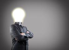 Бизнесмен с лампочкой Стоковое фото RF