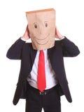 Бизнесмен с бумажной сумкой на головных танцах Стоковые Изображения