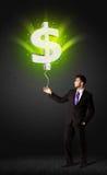 Бизнесмен с воздушным шаром знака доллара Стоковые Изображения RF