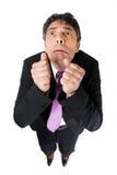 Бизнесмен с вспугнутое пугливым Стоковые Фото