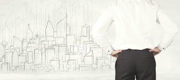 Бизнесмен с вычерченным видом на город Стоковое фото RF
