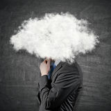 Бизнесмен с головой в облаках Стоковые Изображения RF