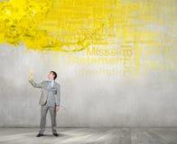 Бизнесмен с желтым приемником Стоковые Изображения RF