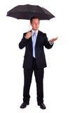Бизнесмен с зонтиком стоковое фото rf