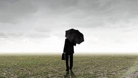 Бизнесмен с зонтиком Стоковые Изображения