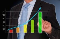 Бизнесмен с диаграммой продаж Стоковое фото RF