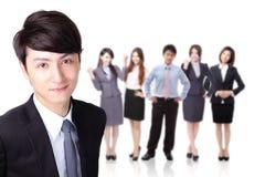Бизнесмен с командой группы Стоковое фото RF