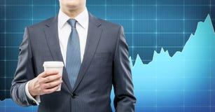 Бизнесмен с кофе, проломом Стоковое Изображение