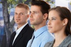 Бизнесмен с коллегами стоковое изображение