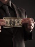 Бизнесмен с 100 долларами стоковое изображение