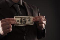 Бизнесмен с 100 долларами стоковая фотография rf
