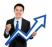 Бизнесмен с поднимающим вверх символом диаграммы в руке стоковые изображения