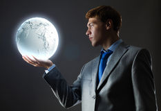 Бизнесмен с луной стоковые фото
