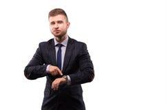 Бизнесмен с усмешкой указывает к вахте Стоковые Изображения RF
