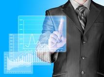 Бизнесмен с финансовыми символами стоковые изображения rf