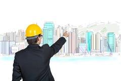 Бизнесмен указывая на небоскреб Стоковые Изображения