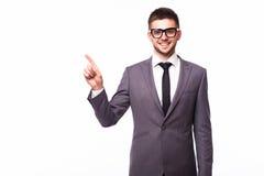 Бизнесмен указывая палец прочь над серой предпосылкой Стоковая Фотография RF