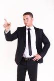 Бизнесмен указывая что-то Стоковые Изображения