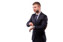 Бизнесмен указывая для того чтобы наблюдать и оскалы стоковая фотография rf