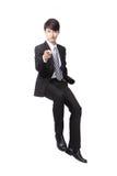Бизнесмен усмехаясь и указывая к вам Стоковые Фотографии RF