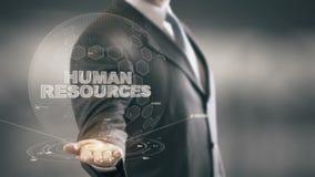 Бизнесмен человеческих ресурсов держа в новых технологиях руки видеоматериал