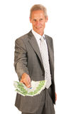 Бизнесмен давая евро Стоковое Фото
