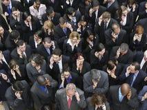 Бизнес-группа используя мобильные телефоны Стоковая Фотография