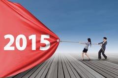 2 бизнес-леди вытягивают знамя Стоковое Изображение RF