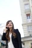 Бизнес-леди в городской предпосылке на pho Стоковое Изображение RF
