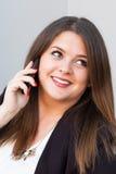 Бизнес-леди говоря на телефоне Стоковое Изображение