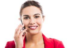 Бизнес-леди говоря на телефоне Стоковые Изображения