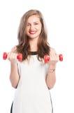 Бизнес-леди держа 2 малых веса Стоковые Изображения