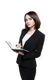 Бизнес-леди держа дневник и ручку изолированными на белизне Стоковые Фото