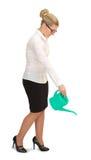 Бизнес-леди моча что-то - изолированный над белой предпосылкой Стоковая Фотография