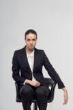Бизнес-леди на стуле Стоковое Изображение RF