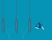 Бизнес-леди скача через обручи Стоковые Фото