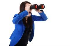 Бизнес-леди смотря через бинокли Стоковое фото RF