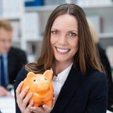 Бизнес-леди с копилкой Стоковое фото RF