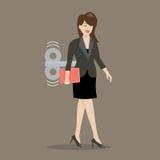 Бизнес-леди с ключом ветра-вверх в ей назад Стоковое фото RF