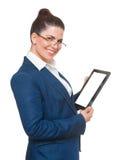 Бизнес-леди с стеклами используя таблетку Стоковое фото RF
