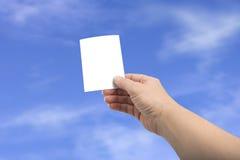билет изолированный рукой Стоковые Фотографии RF