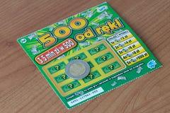Билет царапины Lotto и монетка 5 злотых стоковое фото rf