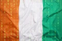 Бинарный код с флагом Кот-д'Ивуар, концепция защиты данных Стоковая Фотография
