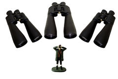 Бинокли смотря человека наблюдая или шпионя Стоковое фото RF